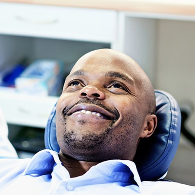 A man reclining in a dental chair