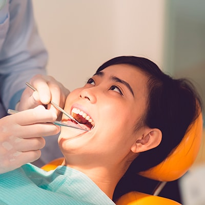 Our dentist performing an oral cancer screening on a patient
