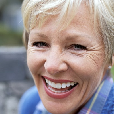 An older blonde woman laughing