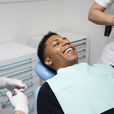 A man lying in a dental chair