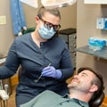One of our doctors about to check the teeth of a man who is lying in the dentist's chair