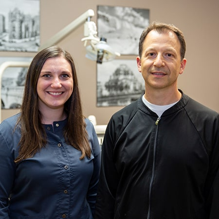 Dr. Berardi with Dr. Hetterich inside the dental office smilling